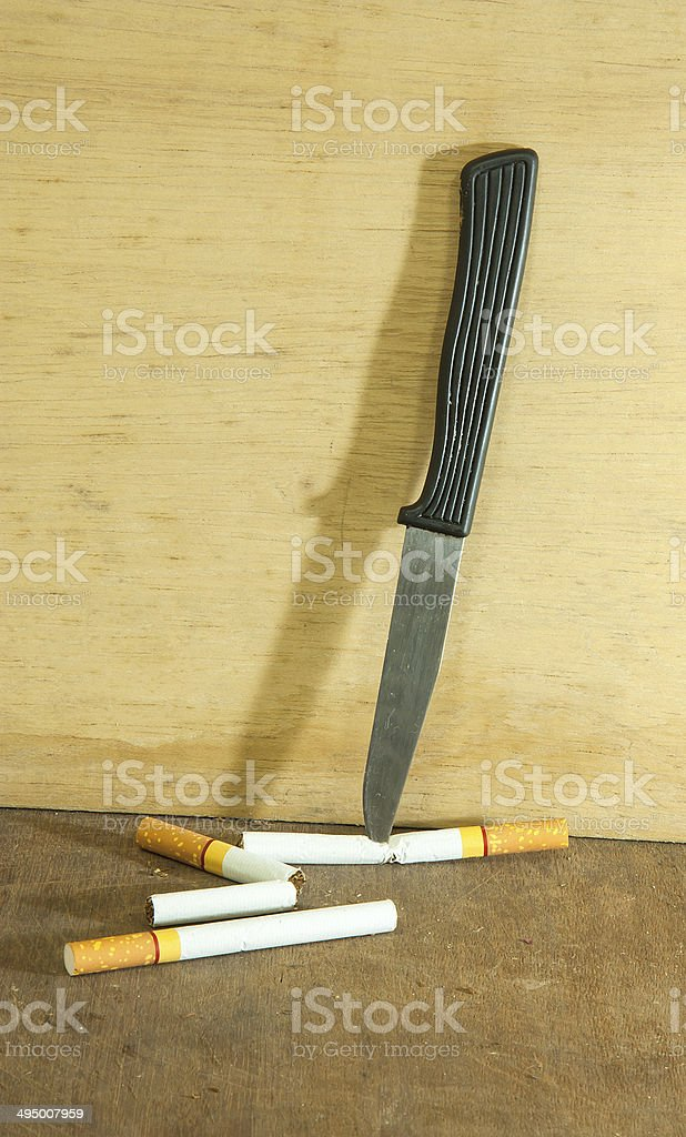 Cigarettes and knives stock photo
