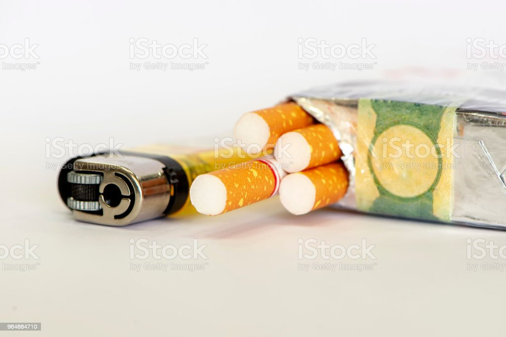 Cigarettes and lighter royalty-free stock photo
