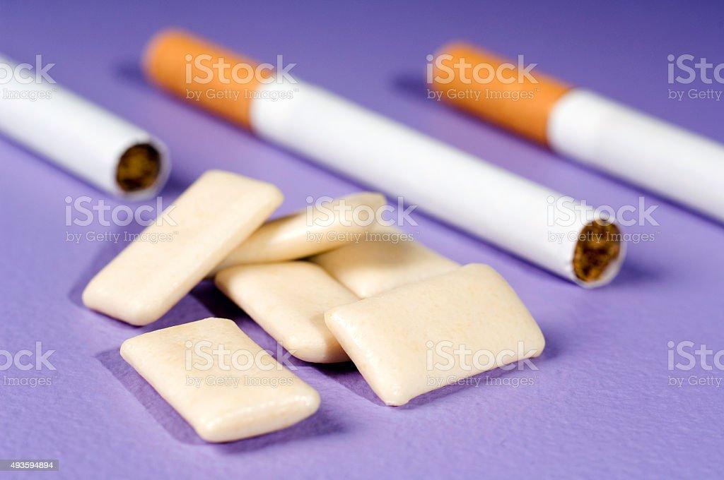 Cigarettes and nicorette nicotine chewing gum stock photo