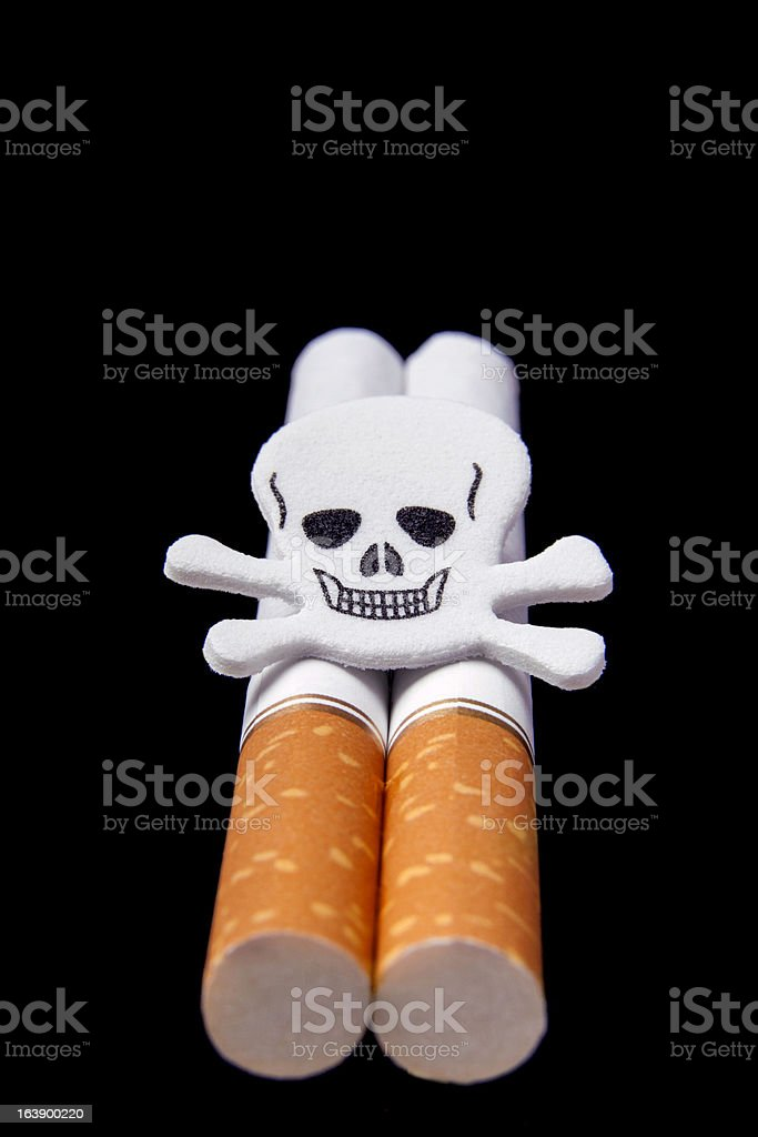Cigarettes and scull on blue background stock photo