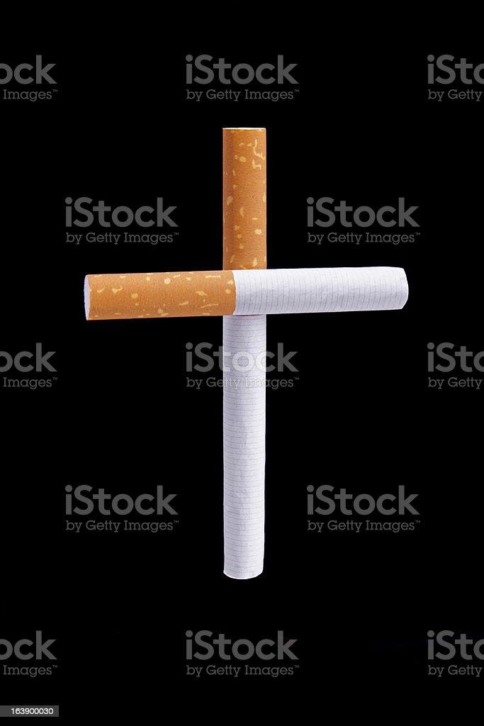 Cigarettes cross metaphor stock photo