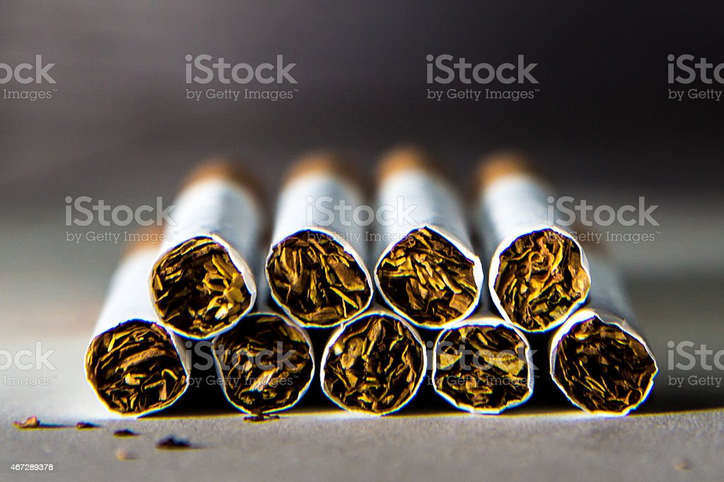 Cigarettes in a row double stock photo