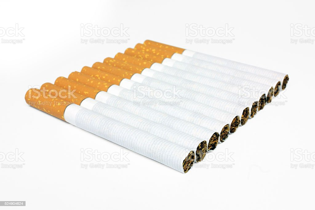 Cigarettes in line isolated stock photo