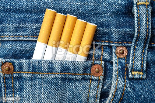 cigarettes in the jeans pocket on front side