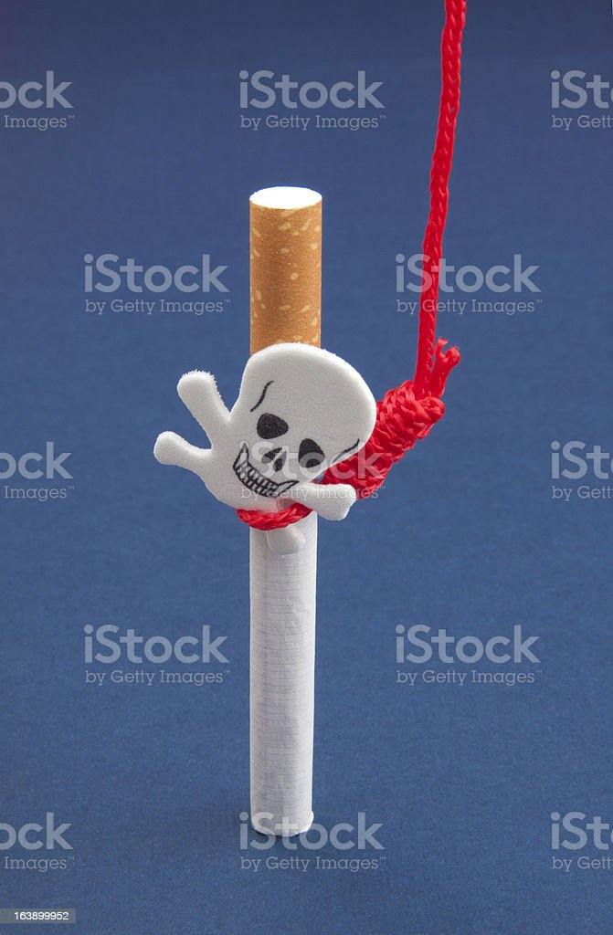 Cigarettes with scull and hanging rope stock photo