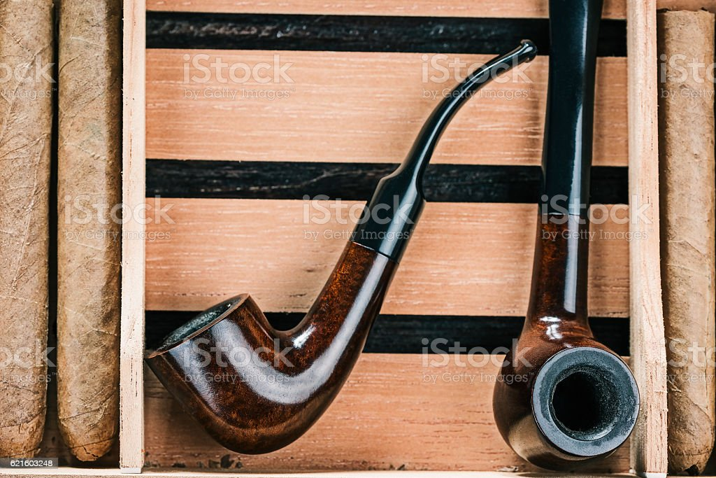 Cigars and pipes stock photo