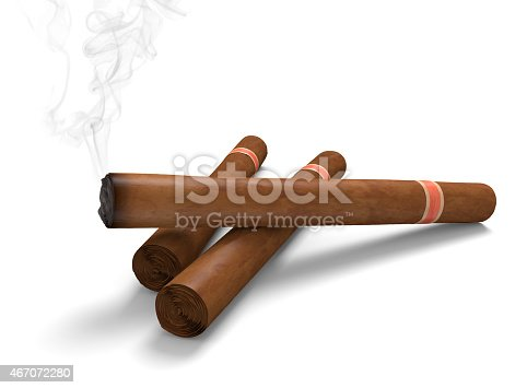istock Cigars on a white background, with one emitting smoke 467072280