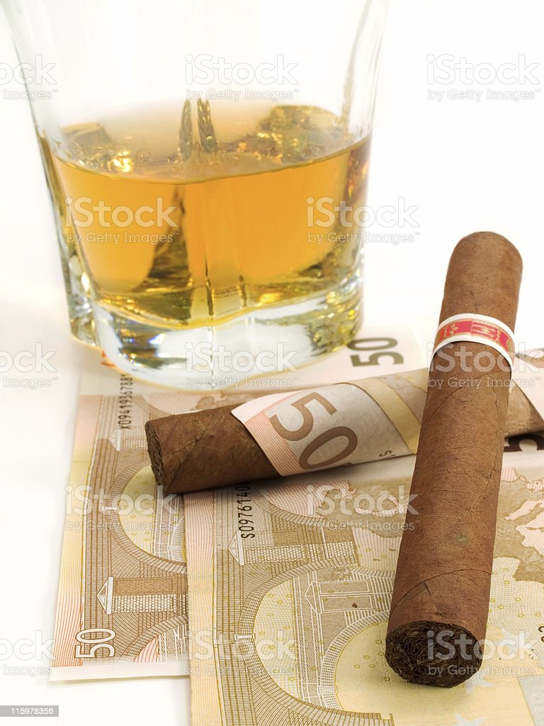 Cigars, Whiskey and Money royalty-free stock photo