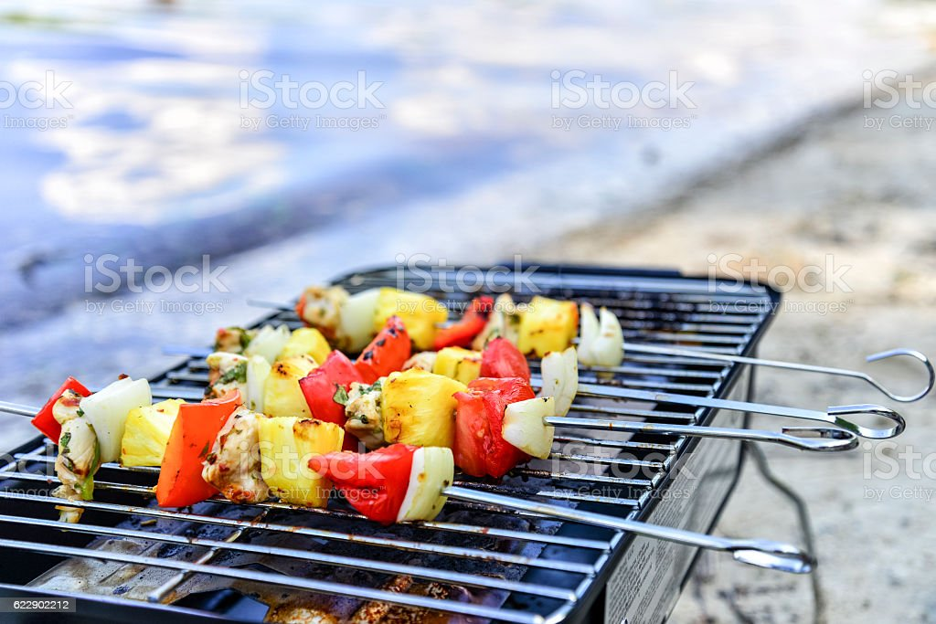 Cilantro Lime Chicken Skewers on Grill at Beach stock photo