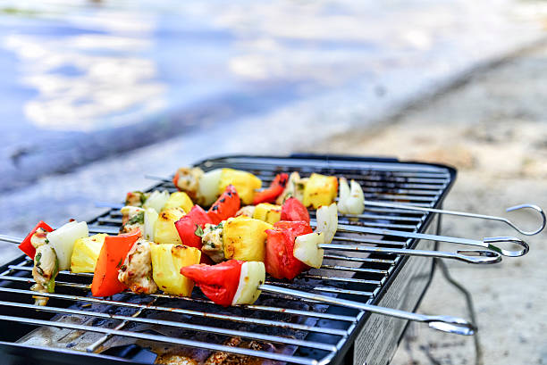 Cilantro Lime Chicken Skewers on Grill at Beach - Photo