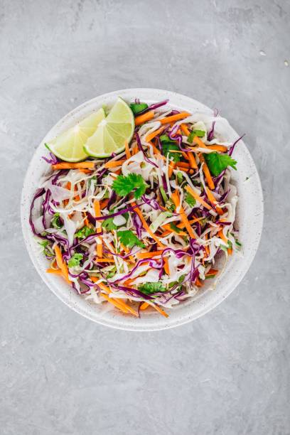 cilantro lime coleslaw salad with red and white cabbage on stone background - coleslaw stock pictures, royalty-free photos & images