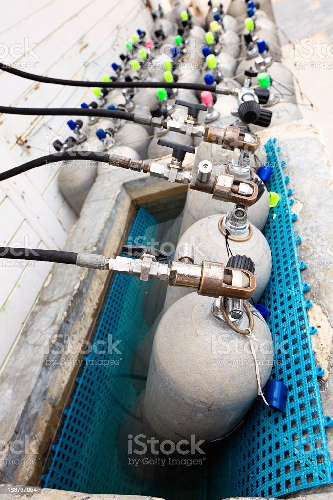 Cilinder air charging at a diving facility royalty-free stock photo