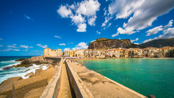 cily Island with the view of Cefalu bridge in the sea, Italy, Europe - foto stock