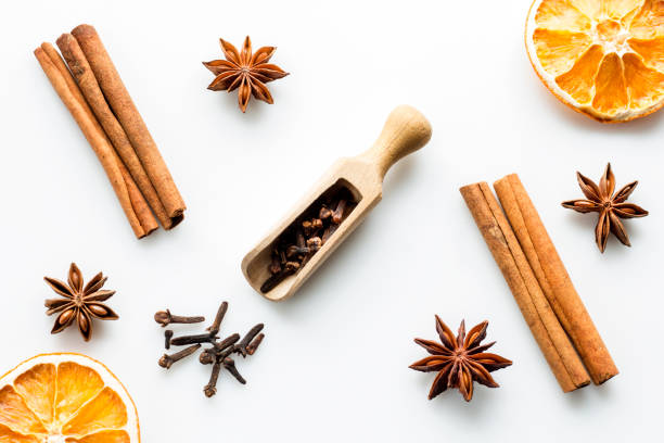 cinanmon, star anise and orange slices cinanmon, star anise and orange slices on white background clove spice stock pictures, royalty-free photos & images