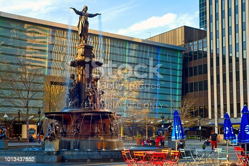 Cincinnati, OH, USA - April 12, 2018: The Tyler Davidson Fountain, titled The Genius of Water, is the centerpiece of this city's main plaza. The bronze statue, was dedicated in 1871 and refurbished in 2006.