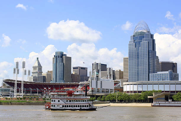 Cincinnati Riverfront Skyline The Ohio River on a sunny day with the skyline of the city of Cincinnati in the background.  A steamboat sails by in the foreground. Shot in 2011 and includes the Queen City Tower, completed in 2011. cincinnati stock pictures, royalty-free photos & images
