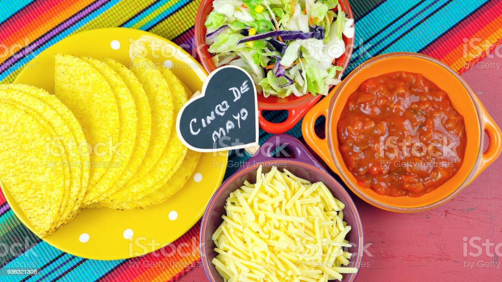 Cinco de Mayo bright colorful party with ingredients for assembling tacos stock photo