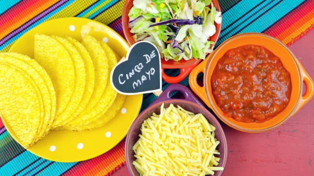 cinco de mayo bright colorful party with ingredients for assembling tacos - cinco de mayo stock photos and pictures