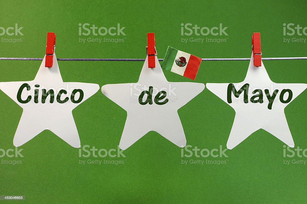 Cinco de Mayo greeting written across pegs on a line stock photo