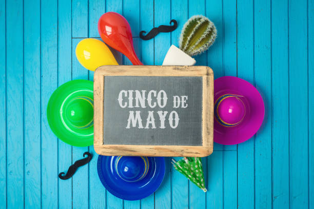 cinco de mayo holiday background with chalkboard, mexican cactus and party sombrero hat on wooden board. - cinco de mayo party stock photos and pictures