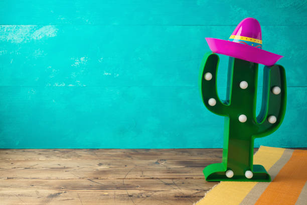 cinco de mayo holiday background with mexican cactus and  party sombrero hat on wooden table - cinco de mayo party stock photos and pictures