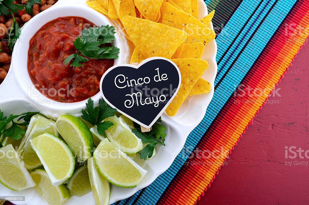 Cinco de Mayo party table with food platter. stock photo