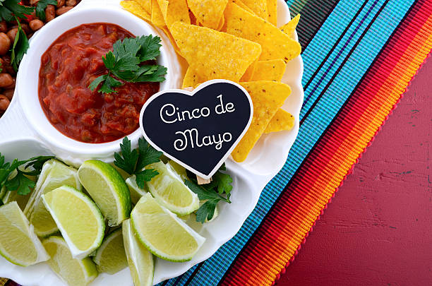 cinco de mayo party table with food platter. - cinco de mayo stock photos and pictures