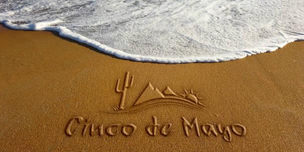 cinco de mayo sand wave beach text. photo image - cinco de mayo stock photos and pictures