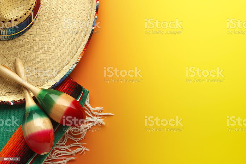 Cinco de Mayo Sombrero and Maracas On Yellow Background stock photo