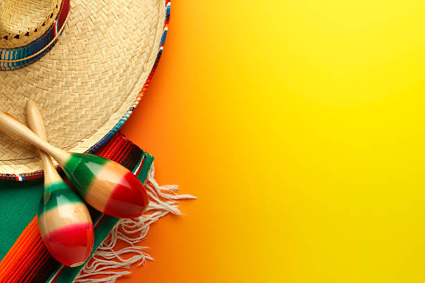 Cinco de Mayo Sombrero and Maracas On Yellow Background A sombrero and maracas. mexican culture stock pictures, royalty-free photos & images