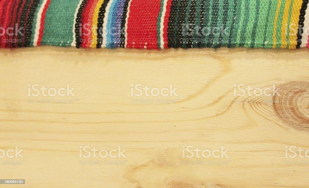 cinco de mayo wooden fiesta mexican poncho serape wooden background stock photo