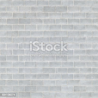 A wall made of concrete masonry units (concrete bricks) which are widely used in construction.