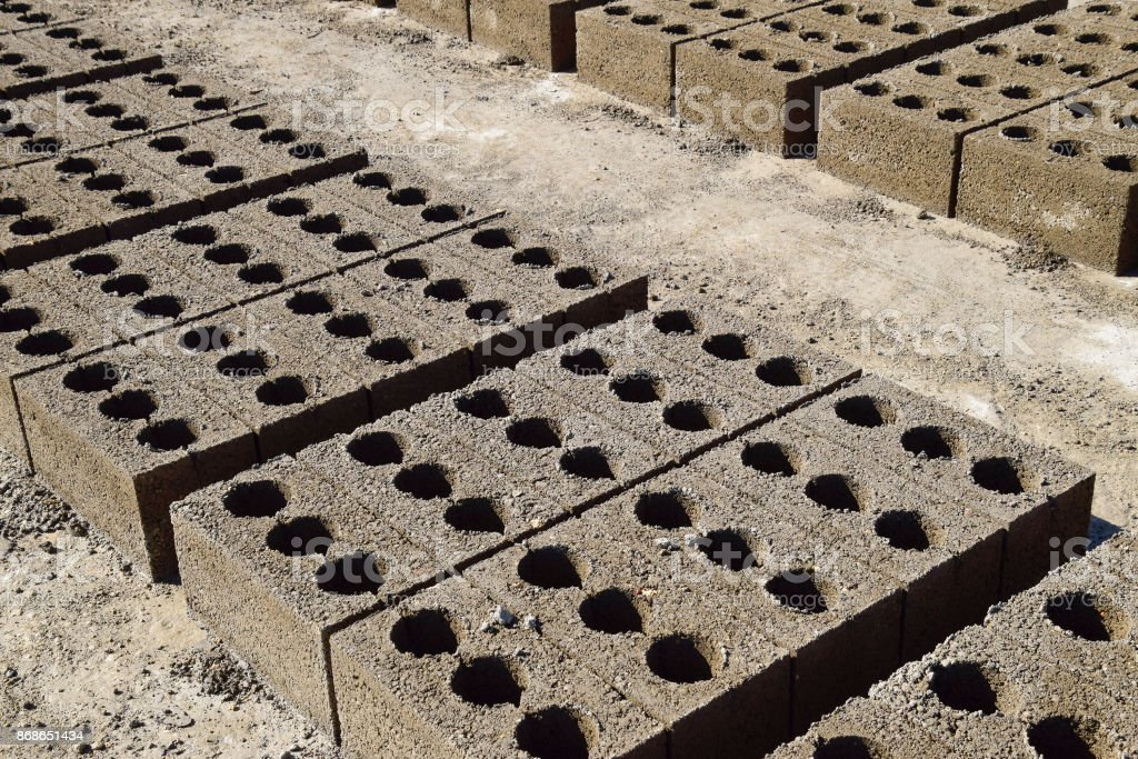 Cinder blocks lie on the ground and dried. on cinder block production...