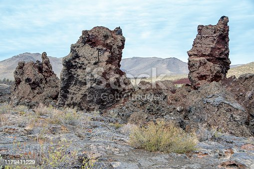 Cinder monoliths, probably fragments of the North Crater rim carried away by a lava flow. Craters of the Moon National Monument, Idaho, USA.