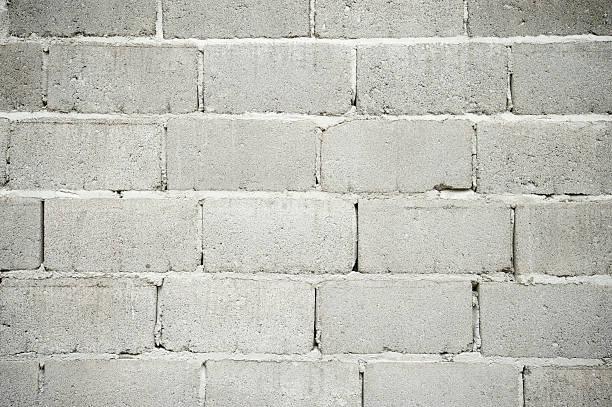 raue cinderblock wand grauen hintergrund full frame - betonblock wände stock-fotos und bilder