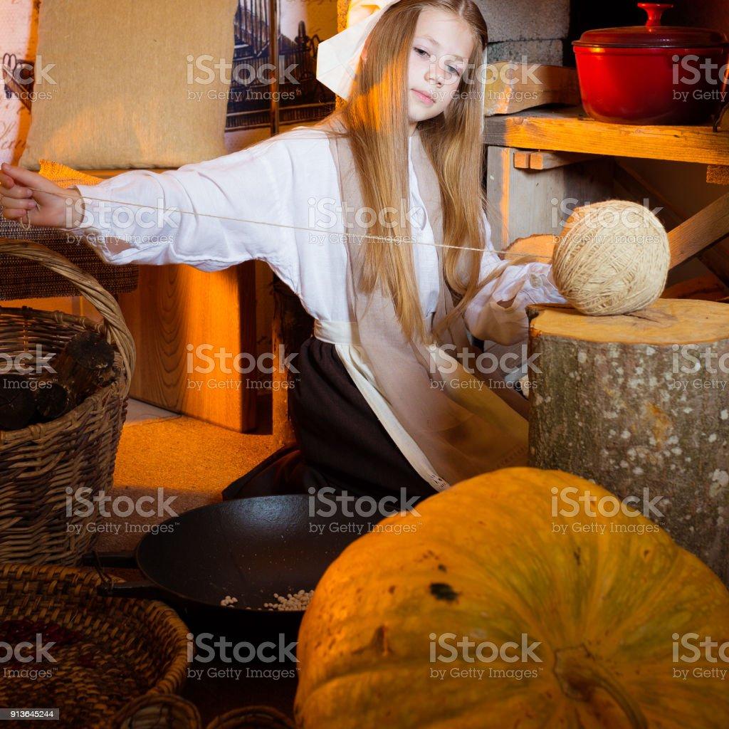 Cinderella Near Fireplace Working In Kitchen stock photo