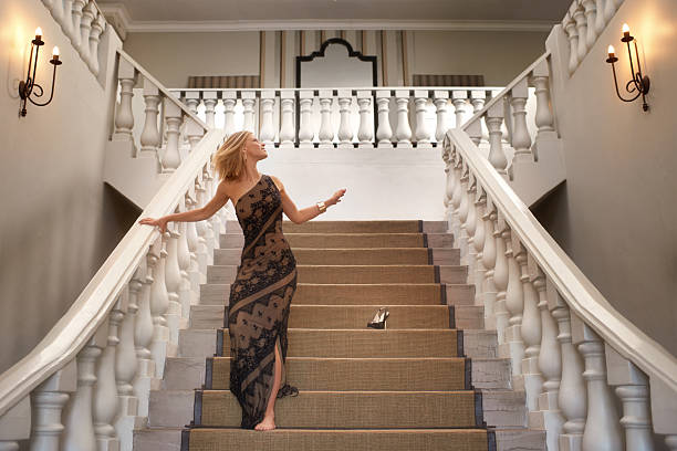 Cinderella story A young woman losing a shoe while running down a magnificent staircase evening wear stock pictures, royalty-free photos & images