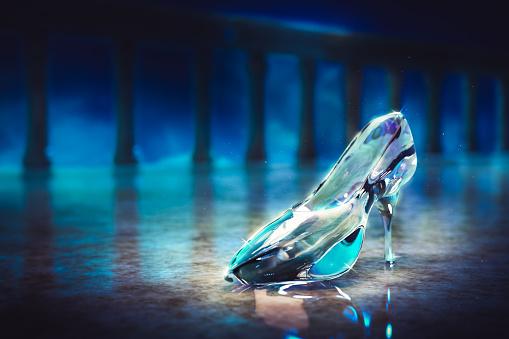 Cinderella's glass slipper on castle's floor/ 3D rendering