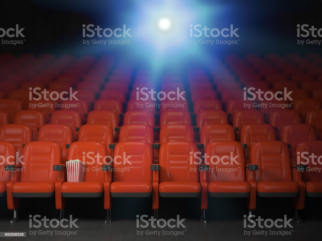 Cinema and movie theater concept background. Empty rows of red seats with pop corn. stock photo