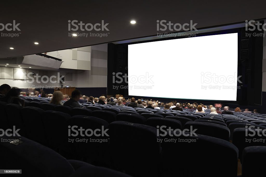 Cinema auditorium with people. stock photo