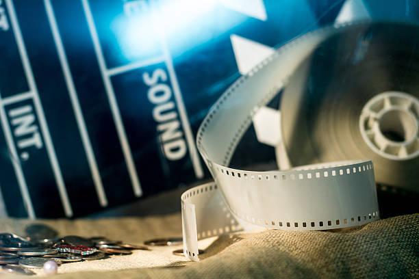 Cinema clapper and video film negative movie stock photo