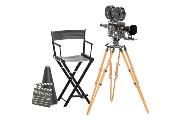 Cinema concept. Movie camera with film reels, chair, megaphone and clapperboard. 3D rendering isolated on white background stock photo