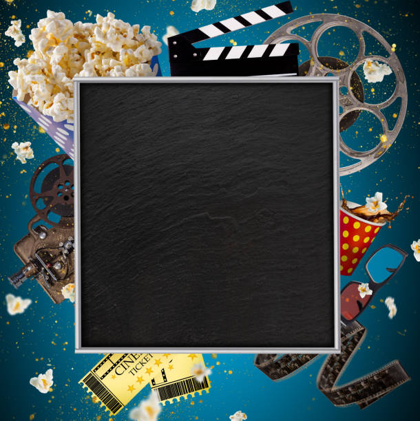 Cinema concept of vintage film reels, clapperboard and other tools stock photo