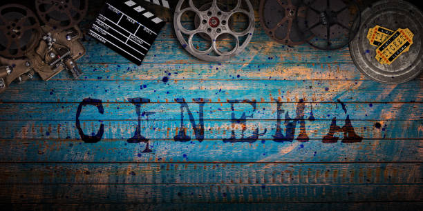 Cinema concept of vintage film reels, clapperboard and projector stock photo