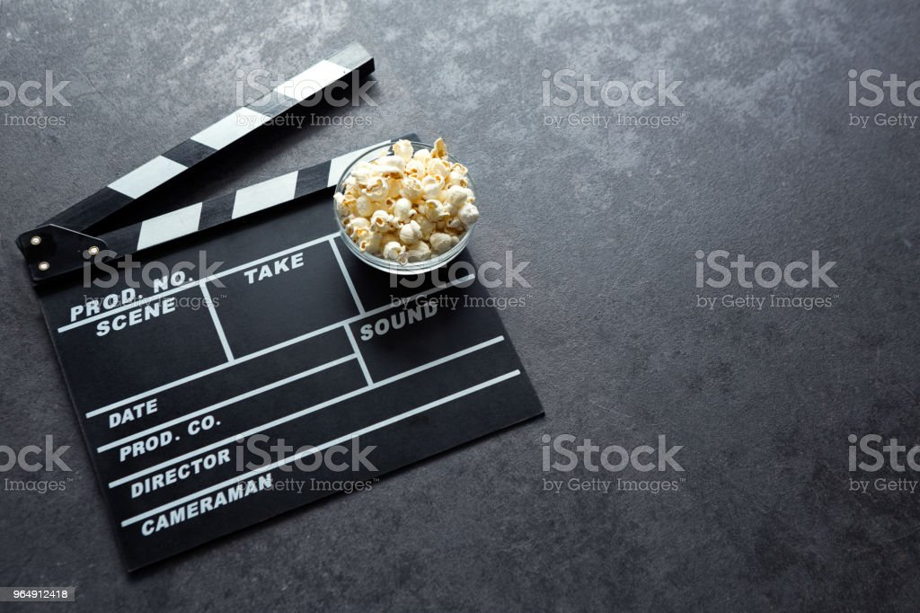 Cinema concept with movie theatre elements set of clapper board and popcorn royalty-free stock photo