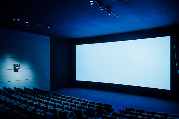 cinema dark movie teather - projection screen stock photos and pictures