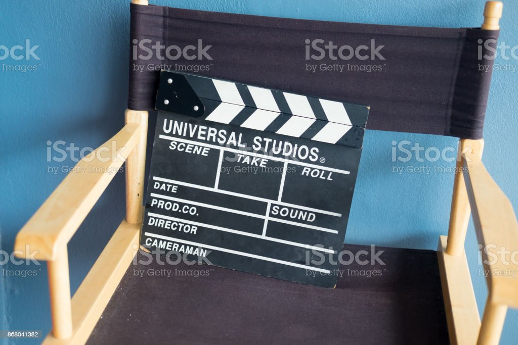 Cinema director chair and clapper, close up stock photo