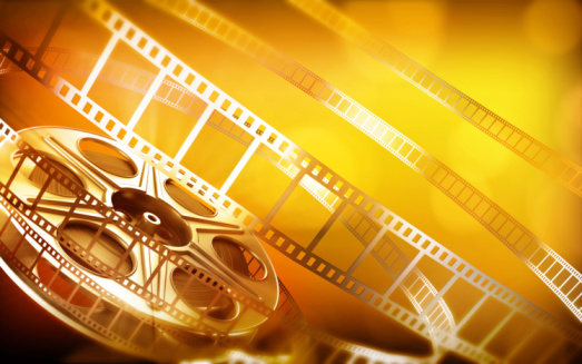 Cinema film reel (gold colors)