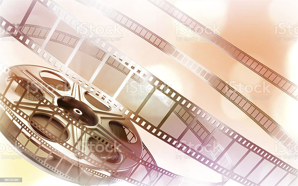 Cinema film reels over light orange and pink background royalty-free stock photo