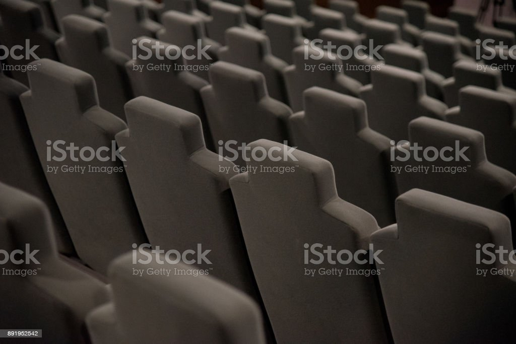Cinema hall with beige armchairs stock photo